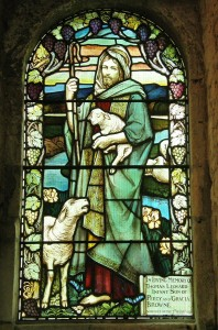 Christ depicted as a shepherd, holding a lamb as he cares for His sheep