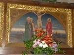 A painting of the crucifixion in the reredos showing St. Mary Magdalene as well as Our Lady and St. John
